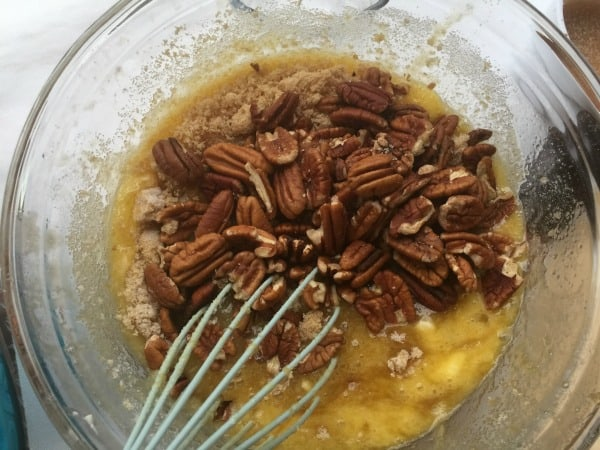 Adding pecans to pecan pie cobbler ingredients