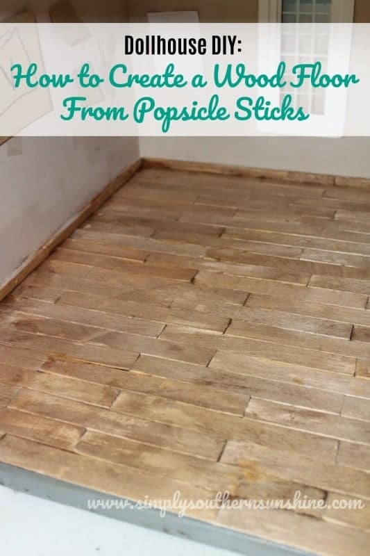 cut and stained popsicle sticks on the floor of a dollhouse