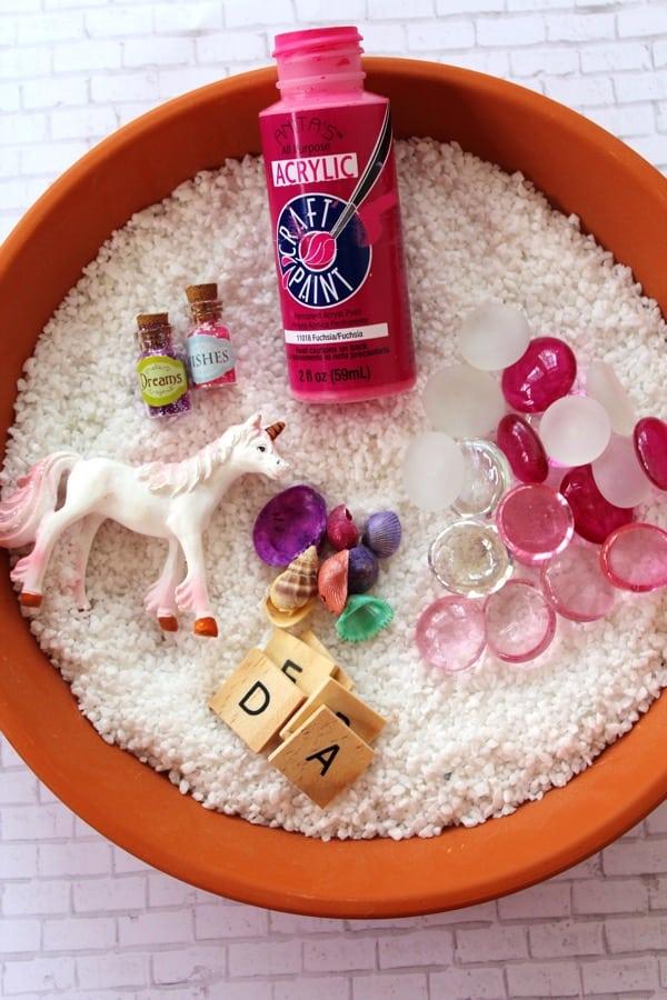 Supplies to create a unicorn fairy garden
