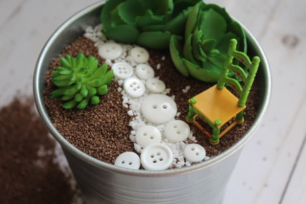 Bucket fairy garden with faux plants