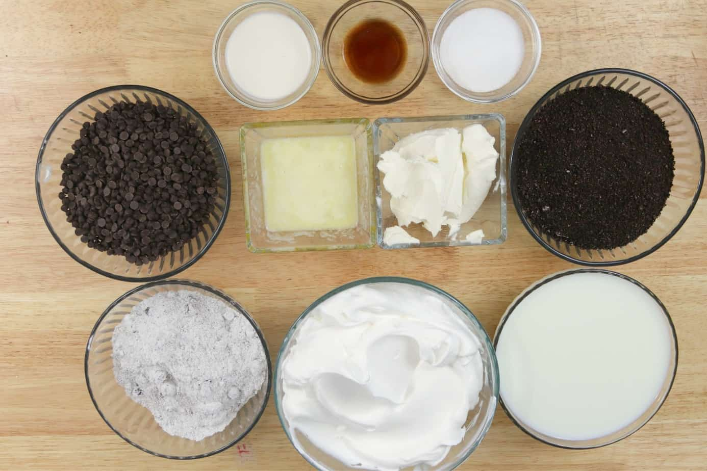 oreo chocolate lasagna ingredients in glass bowls