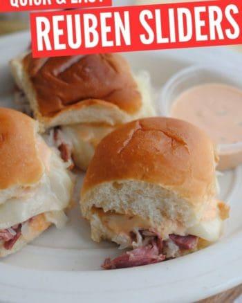 reuben sliders on hawaiian rolls on a white plate