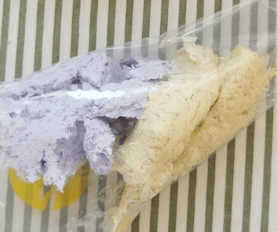 whipped soap with herbs in piping bag